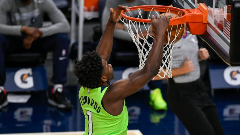 Anthony Edwards takes flight and hammers home the dunk for the Minnesota Timberwolves against the Portland Trail Blazers.