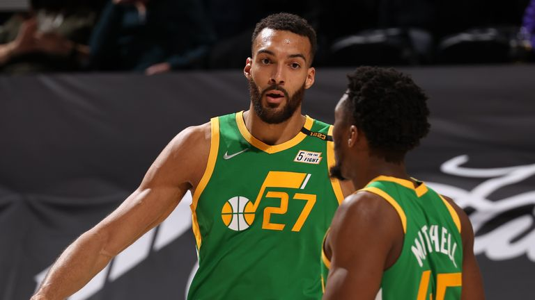 SALT LAKE CITY, UT - MARCH 12: Rudy Gobert #27 and Donovan Mitchell #45 of the Utah Jazz hi-five during the game against the Houston Rockets on March 12, 2021 at vivint.SmartHome Arena in Salt Lake City, Utah. NOTE TO USER: User expressly acknowledges and agrees that, by downloading and or using this Photograph, User is consenting to the terms and conditions of the Getty Images License Agreement. Mandatory Copyright Notice: Copyright 2021 NBAE