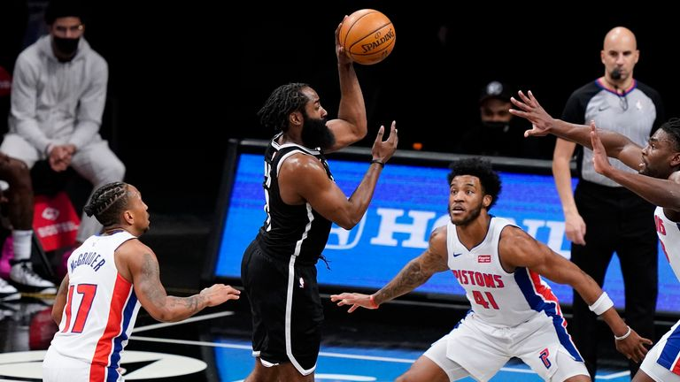 Brooklyn Nets guard James Harden (13) passes the ball as Detroit Pistons forward Saddiq Bey (41), guard Rodney McGruder (17) and center Isaiah Stewart (28) defend during the second half of an NBA basketball game Saturday, March 13, 2021, in New York.