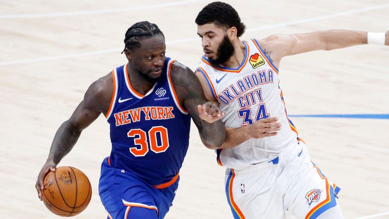 New York Knicks forward Julius Randle (30) goes against Oklahoma City Thunder guard Kenrich Williams (34) during the second half of an NBA basketball game, Saturday, March 13, 2021, in Oklahoma City.