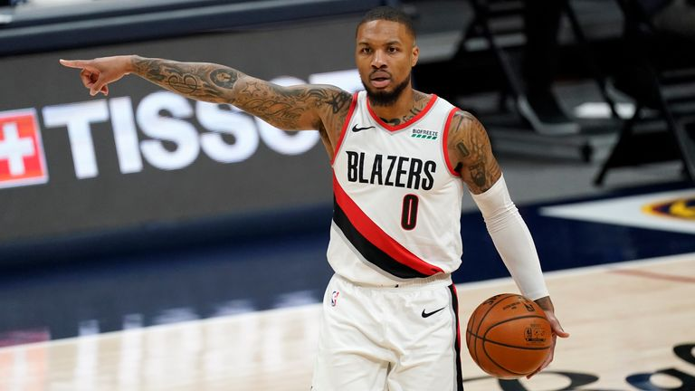 ortland Trail Blazers guard Damian Lillard directs his teammates against the Denver Nuggets in the second half of an NBA basketball game on Tuesday, Feb. 23, 2021, in Denver.