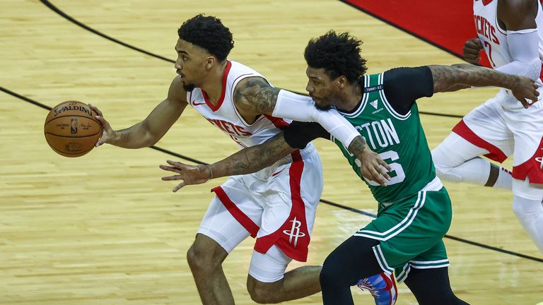 Marcus Smart lunges to steal the ball from Houston Rockets forward Kenyon Martin Jr