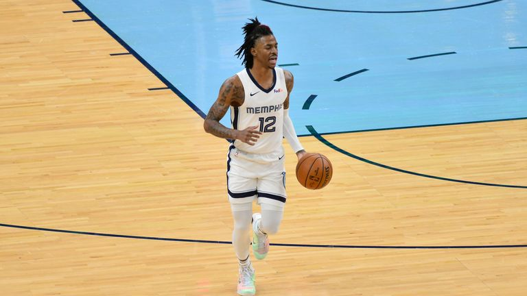 Memphis Grizzlies guard Ja Morant (12) brings the ball up court in the first half of an NBA basketball game against the Washington Wizards Wednesday, March 10, 2021, in Memphis, Tenn. (AP Photo/Brandon Dill)