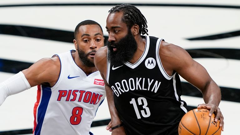 Brooklyn Nets guard James Harden (13) drives past Detroit Pistons guard Wayne Ellington (8) during the first half of an NBA basketball game Saturday, March 13, 2021, in New York.