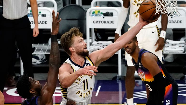 Indiana Pacers forward Domantas Sabonis (11) drives past Phoenix Suns center Deandre Ayton (22) during the first half of an NBA basketball game Saturday, March 13, 2021, in Phoenix.
