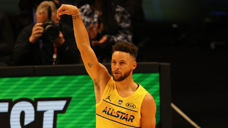 Steph Curry holds his follow through after sinking his final shot to claim the 2021 NBA All-Star 3-Point Contest