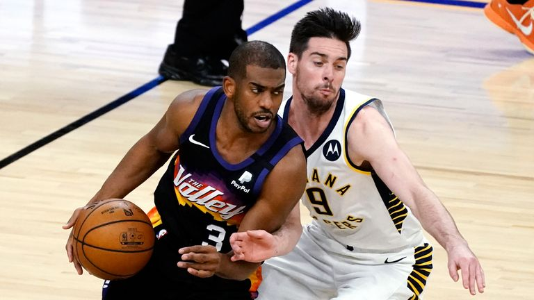 Phoenix Suns guard Chris Paul (3) drives past Indiana Pacers guard T.J. McConnell during the second half of an NBA basketball game Saturday, March 13, 2021, in Phoenix. The Pacers won 122-111.