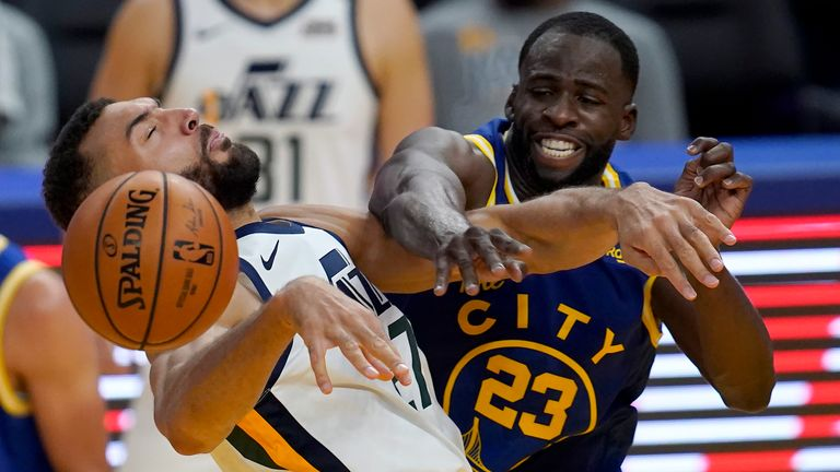 Utah Jazz center Rudy Gobert, left, is fouled by Golden State Warriors forward Draymond Green (23) during the second half of an NBA basketball game in San Francisco, Sunday, March 14, 2021. (AP Photo/Jeff Chiu)