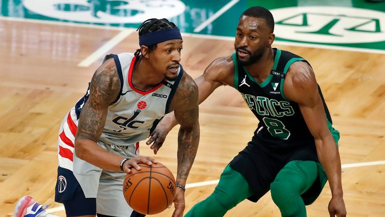 Boston Celtics' Kemba Walker (8) defends against Washington Wizards' Bradley Beal (3) during the first half of an NBA basketball game, Sunday, Feb. 28, 2021, in Boston.