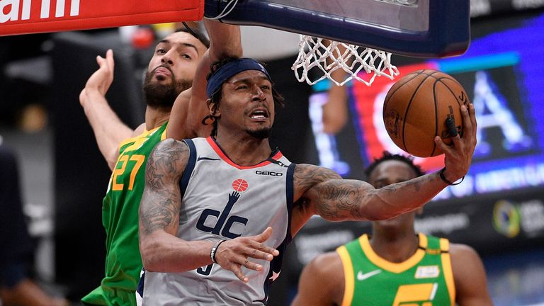 Washington Wizards guard Bradley Beal (3) goes to the basket past Utah Jazz center Rudy Gobert (27) during the second half of an NBA basketball game, Thursday, March 18, 2021, in Washington.