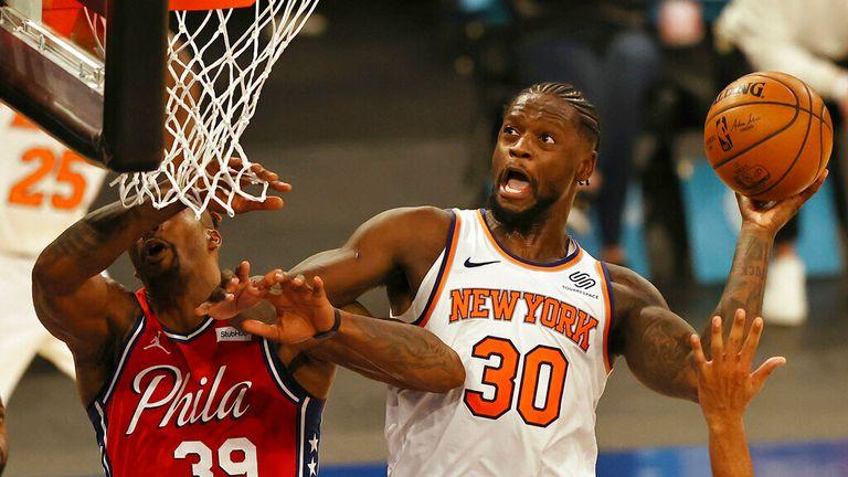 AP - New York Knicks' Julius Randle (30) heads for the net as Philadelphia 76ers' Dwight Howard (39) defends