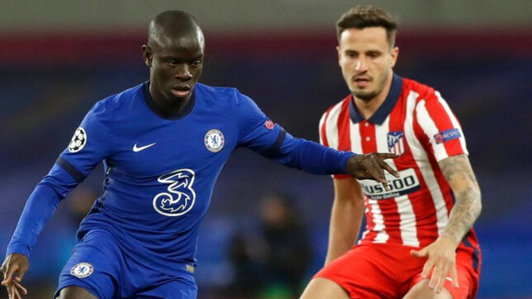 Chelsea's N'Golo Kante, left, is challenged by Atletico Madrid's Saul