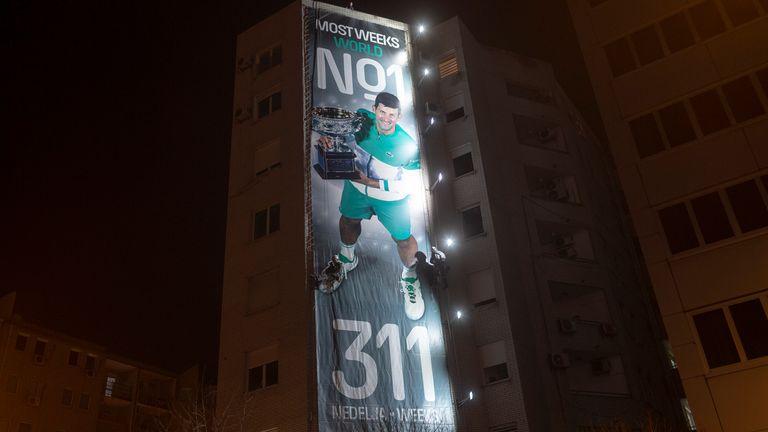 A billboard celebrating Djokovic's achievement is displayed in his homeland of Belgrade, Serbia