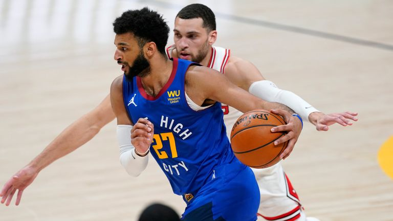 Denver Nuggets guard Jamal Murray drives past Chicago Bulls guard Zach LaVine