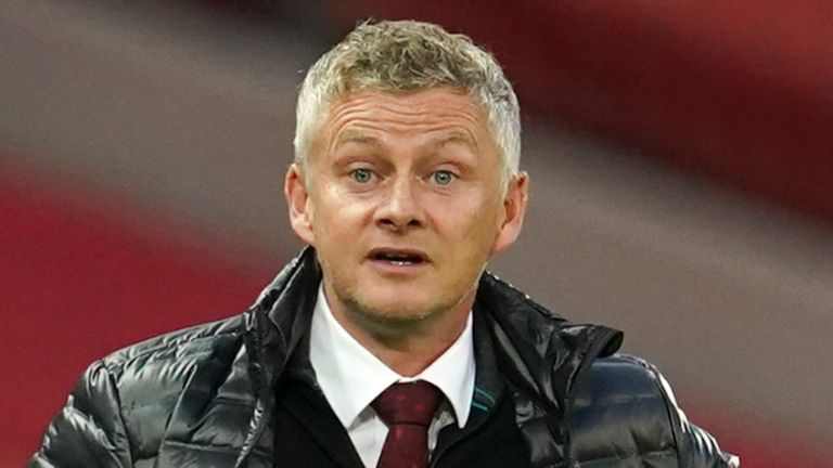 Manchester United...s manager Ole Gunnar Solskjaer gestures as he talks to Manchester United...s Luke Shaw during the English Premier League soccer match between Manchester United and Southampton at Old Trafford in Manchester, England, Monday, July 13, 2020. (AP Photo/Dave Thompson,Pool)..