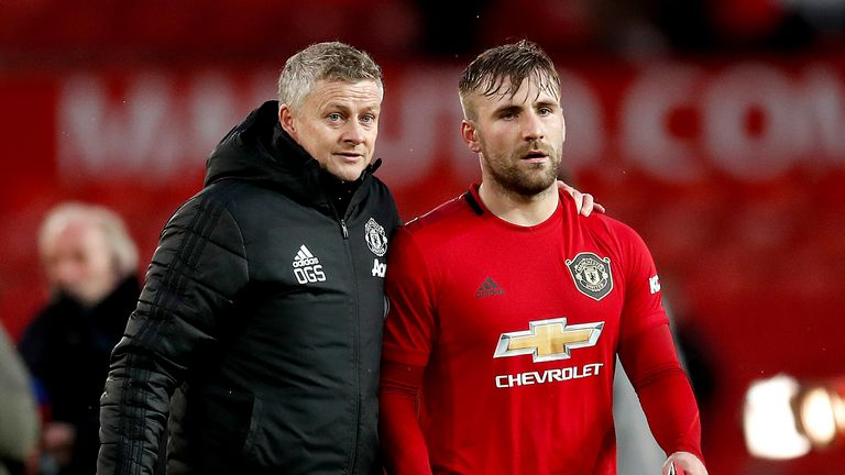 Manchester United manager Ole Gunnar Solskjaer with left-back Luke Shaw