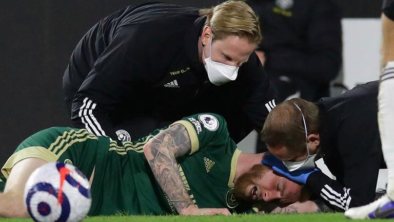 Sheffield United forward Oli McBurnie is treated for a head injury (AP image)