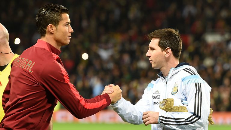 PA - Cristiano Ronaldo and Lionel Messi shake hands before Portugal vs Argentina friendly international