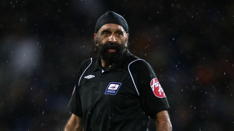 PA - Jarnail Singh refereeing a Championship match between Cardiff City and Ipswich Town in 2009