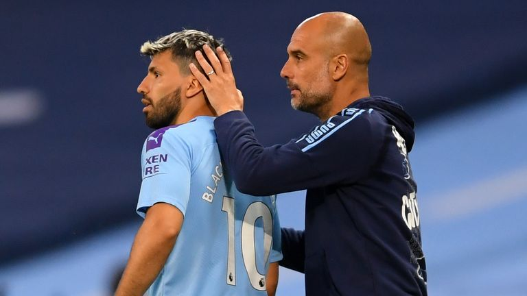 PA - Manchester City striker Sergio Aguero and manager Pep Guardiola
