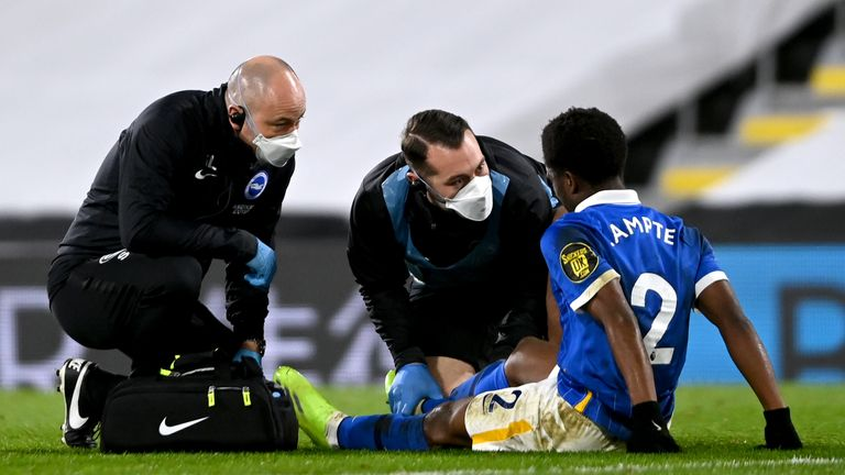 PA - Brighton defender Tariq Lamptey receives treatment on the pitch