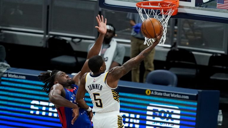 Indiana Pacers' Edmond Sumner puts up a shot against Detroit Pistons' Isaiah Stewart