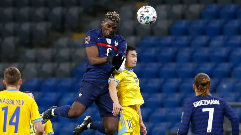 Paul Pogba rises to win the ball for France in the World Cup Qualifier