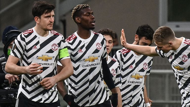 Paul Pogba is congratulated after opening the scoring for Manchester United in Milan