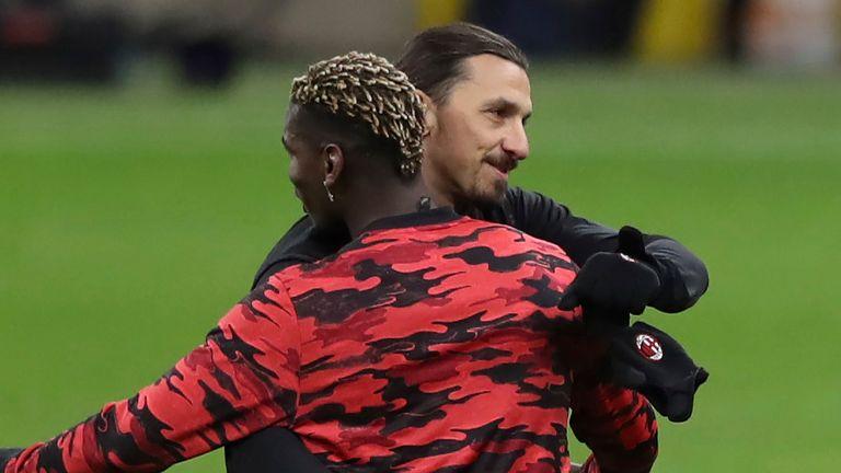 Paul Pogba and Zlatan Ibrahimovic embrace on the touchline at the San Siro