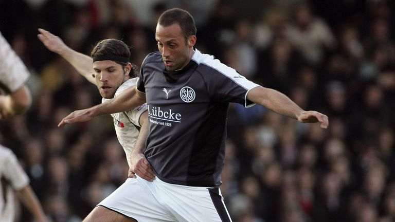 Pellegrino Matarazzo of Wattenscheid is challenged by Benjamin Adrion of St. Pauli during the Third League match between FC St.Pauli and Wattenscheid 09 at the Millerntor Stadium on April 28, 2006 in Hamburg, Germany