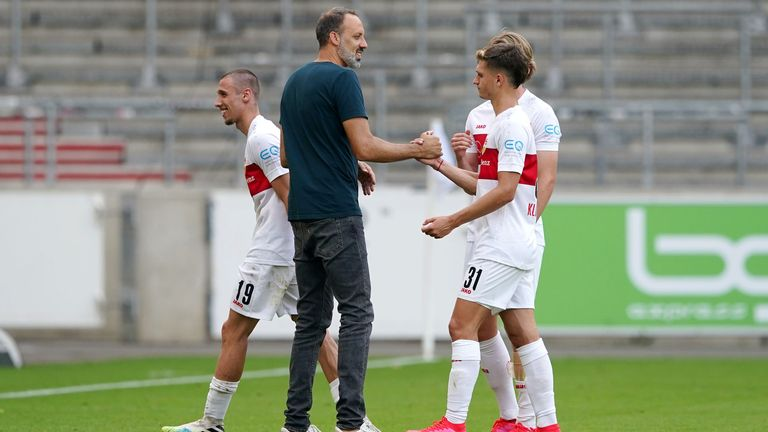 Head Coach of VfB Stuttgart Pellegrino Matarazzo and Mateo Klimowicz of VfB Stuttgart celebrate their promotion after the Second Bundesliga match between VfB Stuttgart and SV Darmstadt 98 at Mercedes-Benz Arena on June 28, 2020 in Stuttgart, Germany.