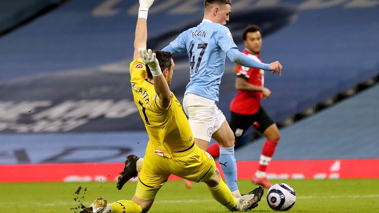 Phil Foden looks to dodge the challenge of McCarthy with the score at 1-1 in the first half