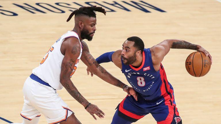 Detroit Pistons guard Wayne Ellington is guarded by New York Knicks forward Reggie Bullock in the second quarter at Madison Square Garden
