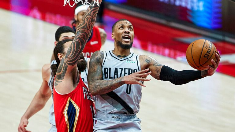 AP - Portland Trail Blazers guard Damian Lillard, right, shoots next to New Orleans Pelicans center Steven Adams