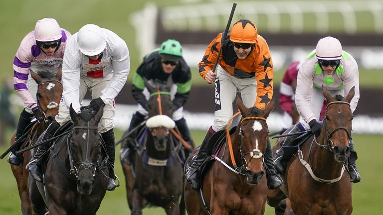 Aidan Coleman riding Put The Kettle On (orange) clears on the way to winning The Betway Queen Mother Champion Chase