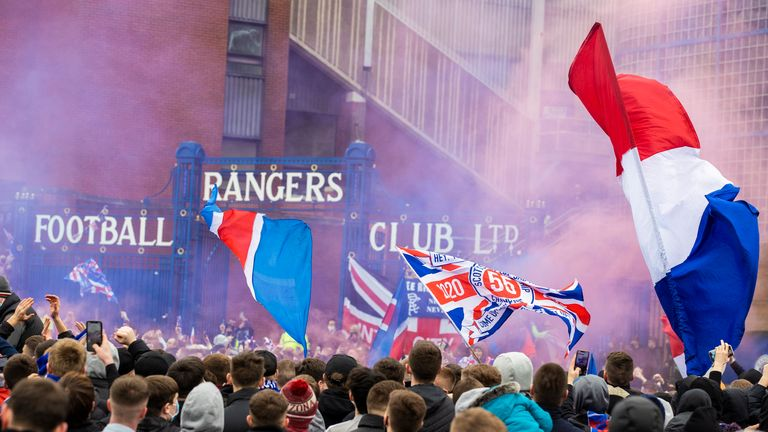 GLASGOW, SCOTLAND - MARCH 06: Rangers fans greet the arrival of their players and manager pre match during a Scottish Premiership match between Rangers and St Mirren at Ibrox Stadium, on March 06, 2021, in Glasgow, Scotland. (Photo by Craig Williamson / SNS Group)