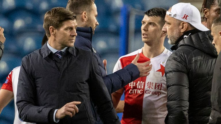 SNS - Rangers manager Steven Gerrard exchanges words with Slavia Prague manager Jindrich Trpisovsky after their exit rom the Europa League