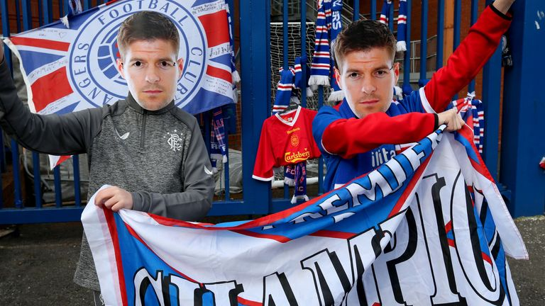 Rangers fans wearing Steven Gerrard masks hold up a banner outside of the Ibrox