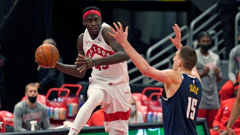 Toronto Raptors forward Pascal Siakam looks to pass around Denver Nuggets center Nikola Jokic