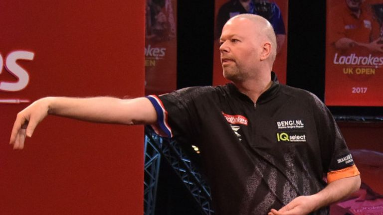 Raymond van Barneveld suffered an early exit in his first televised match since coming out of retirement