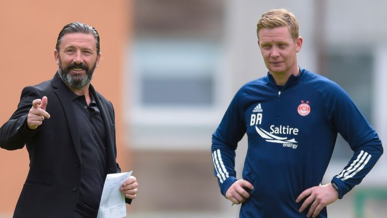 Barry Robson (right) will take interim charge alongside Paul Sheerin after Derek McInnes (left) left Aberdeen