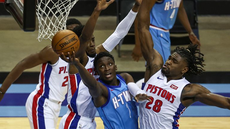 Houston Rockets guard Victor Oladipo shoots the ball as Detroit Pistons center Isaiah Stewart defends
