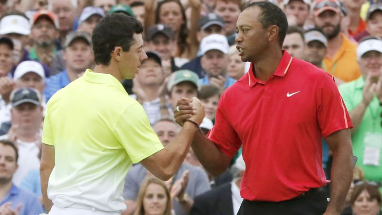 McIlroy shakes hands with Tiger Woods after finishing the final round of the 2015 Masters
