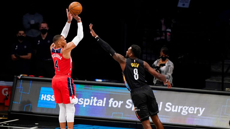 AP - Brooklyn Nets forward Jeff Green (8) defends Washington Wizards guard Russell Westbrook (4) as Westbrook shoots for three points