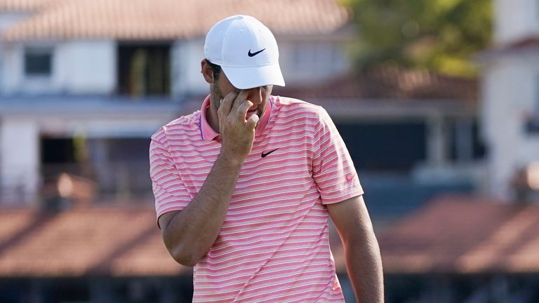 Scheffler shows his frustration after missing a par putt to win the 12th