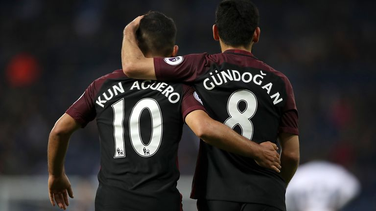 Manchester City's Ilkay Gundogan celebrates scoring his side's fourth goal of the game with team mate Sergio Aguero during the Premier League match at The Hawthorns, West Bromwich.