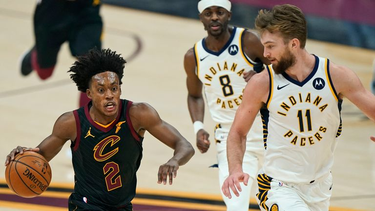 Cleveland Cavaliers' Collin Sexton drives to the basket against Indiana Pacers' Domantas Sabonis