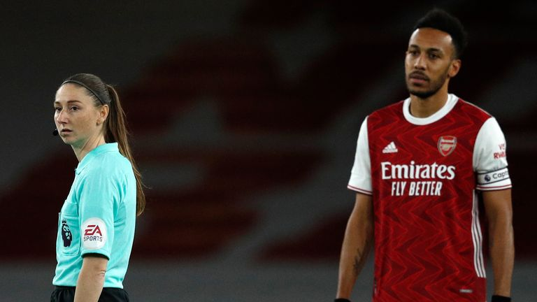 Assistant referee Sian Massey-Ellis stands next to Arsenal's Pierre-Emerick Aubameyang before an English Premier League soccer match between Arsenal and Southampton at the Emirates stadium in London, England, Wednesday, Dec. 16, 2020
