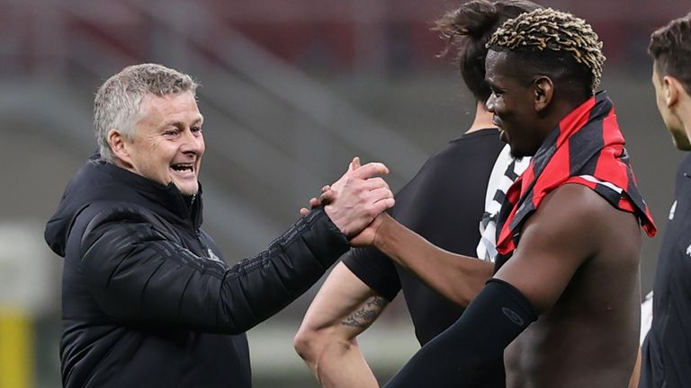 Ole Gunnar Solskjaer greets Paul Pogba after the win in Milan