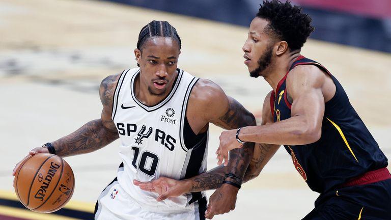 San Antonio Spurs' DeMar DeRozan drives on Cleveland Cavaliers' Lamar Stevens